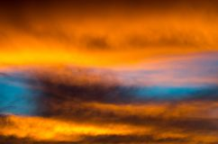 Background texture of dramatic sunset sky with orange clouds after thunderstorm Stock Photography