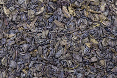 Background and texture of dry green tea. Close up Royalty Free Stock Photo