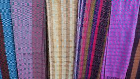 Fabrics on display in a souvenir shop in the town of Paro in Bhutan royalty free stock photo