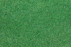 Background texture with fake grass. In a public children playground, top view Royalty Free Stock Photography