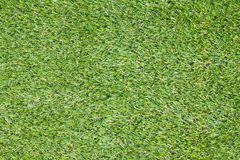 Background texture with fake grass. In a public children playground, top view Royalty Free Stock Image