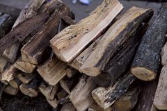 Background texture of folded heaps of dry firewood. Side view, cropped shot, horizontal, close-up. Nature`s concept stock image