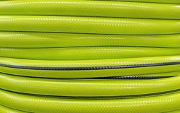 Background and texture of a garden hose. Bright garden hose royalty free stock photo