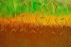Multicolored background texture of glass. Green, yellow, brown grinding glass color. stock image