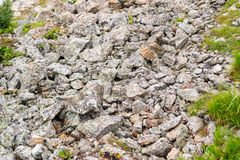 Background texture of a gray brown stone on the rock of the mountain discovered during archaeological excavations as a monument t. Background texture of a gray stock photo
