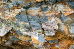 Background texture of a gray brown stone on the rock of the mountain discovered during archaeological excavations as a monument t. Background texture of a gray royalty free stock photography