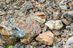 Background texture of a gray brown stone on the rock of the mountain discovered during archaeological excavations as a monument t. O millions of years stock photos