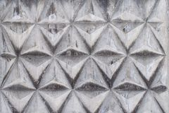 Background texture of gray concrete fence with triangular pattern. Background texture of old gray concrete fence with triangular pattern Stock Image