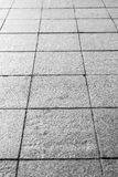 Background. Texture of gray square paving tiles on the entire frame. Vertical frame Royalty Free Stock Photography