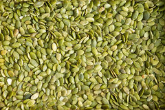 Background texture of green hulled pumpkin seeds Royalty Free Stock Image