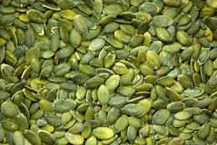 Background texture of green pumpkin seeds. A background texture of green pumpkin seeds Stock Images