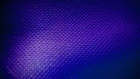 Background texture-grunge fabric large cell. The texture of the netting of large threads grunge fabric purple color Stock Photography