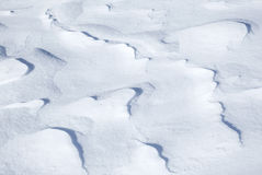 Background texture of hilly snowdrift Royalty Free Stock Photo