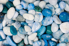 Background texture image. Blue decorative garden pebble aggregat. Blue decorative garden pebble aggregate used for water features and ground cover, Colorful Stock Image