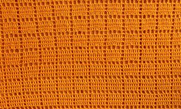 Background texture of knitted orange squares for the desktop, si stock photos