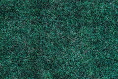 Background a texture a knitted woolen fabric of dark green color. Background a texture a knitted woolen fabric of dark green Stock Images