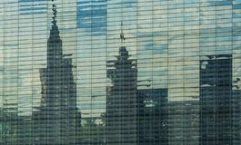 The background or texture from a large number of glass plates in which affects a view of the city and the sky. The background or texture from a large number of royalty free stock photography