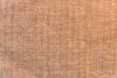 The background, texture of light brown linen fabric Stock Photo