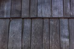 Long weathered wood single. Background texture of long weathered wood shingle tiles Stock Photography