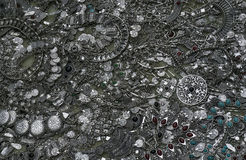 Background, texture of many different shapes and sizes of metal and silver jewelery Stock Photo