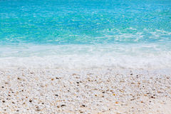 Background texture of Marble Beach stones and waves in Thassos, Greece Stock Image