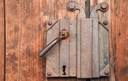 Background texture of a medieval door. Close-up of vintage lock.  royalty free stock photo