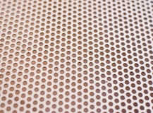 Background texture of a mesh grid with holes. In a repeat uniform pattern viewed at an oblique receding angle, full frame Royalty Free Stock Photo