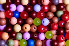 Background texture of multi-colored beads close-up stock photos