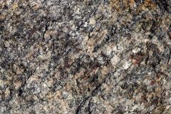 Background texture of natural stone. Black and white mixture of the surface of the stone. royalty free stock images