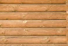 Background texture of the new light-brown wooden logs Stock Photos