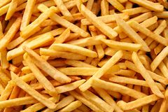 Free Background Texture Of Golden French Fries Stock Images - 136423764