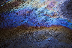 Background texture of an oil spill on road Royalty Free Stock Photos