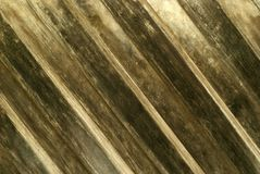 Background, texture: old darkened wooden wall made of overlapped diagonal slats royalty free stock photography