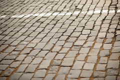 Background texture of old granite cobblestone road Stock Image