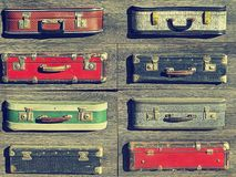 Background texture. Old retro vintage suitcases valise on wooden boards. Collecting gathering in way of vacation road and travel.  Stock Images
