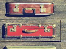 Background texture. Old retro vintage suitcases valise on wooden boards. Collecting gathering in way of vacation road and travel.  Stock Photography