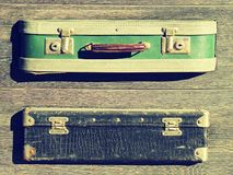 Background texture. Old retro vintage suitcases valise on wooden boards. Collecting gathering in way of vacation road and travel.  Royalty Free Stock Photography