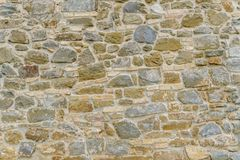 Background of old vintage stone wall. Background or texture of old vintage stone wall Royalty Free Stock Photography