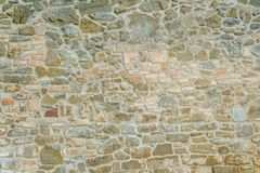 Background of old vintage stone wall. Background or texture of old vintage stone wall Royalty Free Stock Image