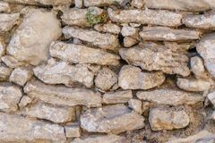 Background of old vintage stone wall. Background or texture of old vintage stone wall Stock Photography