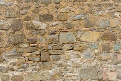 Background of old vintage stone wall. Background or texture of old vintage stone wall Royalty Free Stock Images