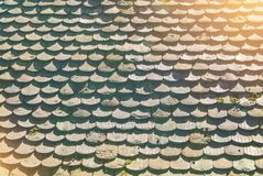 Background texture of old vintage tile roof of old european hous Stock Photos