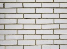 Background texture of a old white brick wall. stock photos