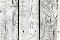 Background texture of old white painted wooden lining boards wall. Fence surface stock photo