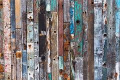 Background texture of old wood planks. Background texture of a wall with different colored old wood planks stock photos
