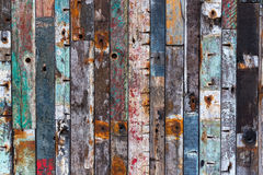 Background texture of old wood planks. Background texture of a wall with different colored old wood planks stock photo