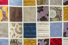 Background texture of a patchwork of different pieces of fabric Royalty Free Stock Photos