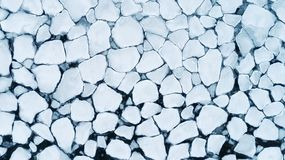 Background texture pattern abstract of ice broken into ice floes floating on frozen winter sea surface royalty free stock image