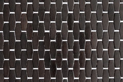 Background texture and pattern of a dark wood mat Stock Images