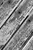 Background Texture - pattern / design of wood, rivets and rust!. Background Texture of wooden slats in a fence, peeling paint flaking, with rusted rivets - black royalty free stock photo